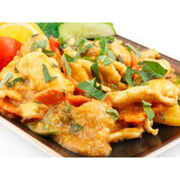 Chicken fillet with chestnuts and vegetables in tomato-peanut sauce with basil